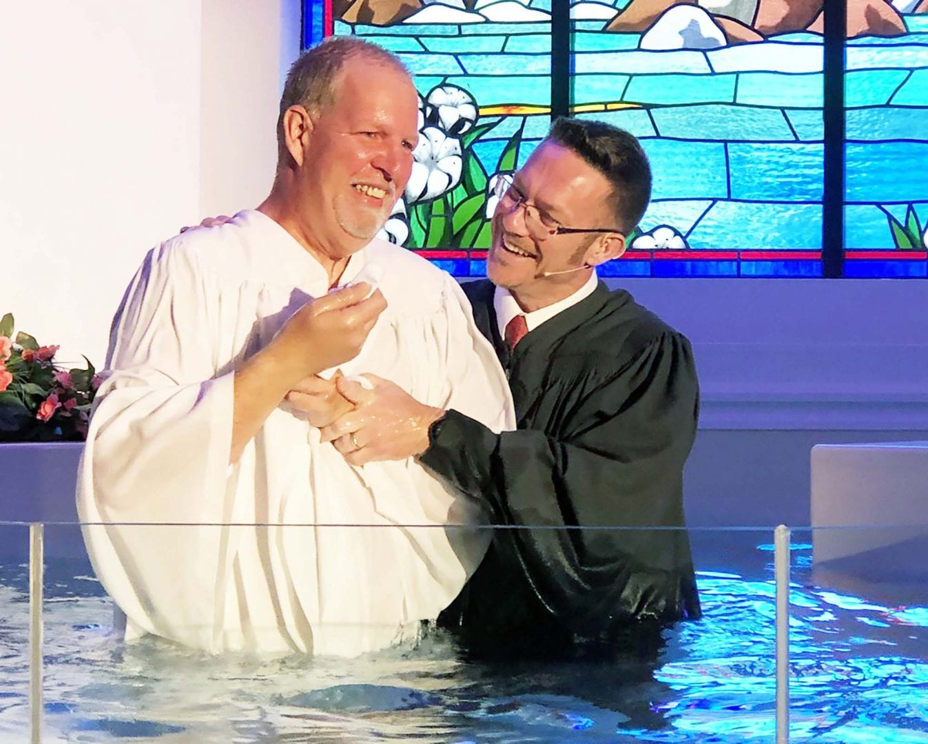 Jeff Reynolds baptizes a new believer