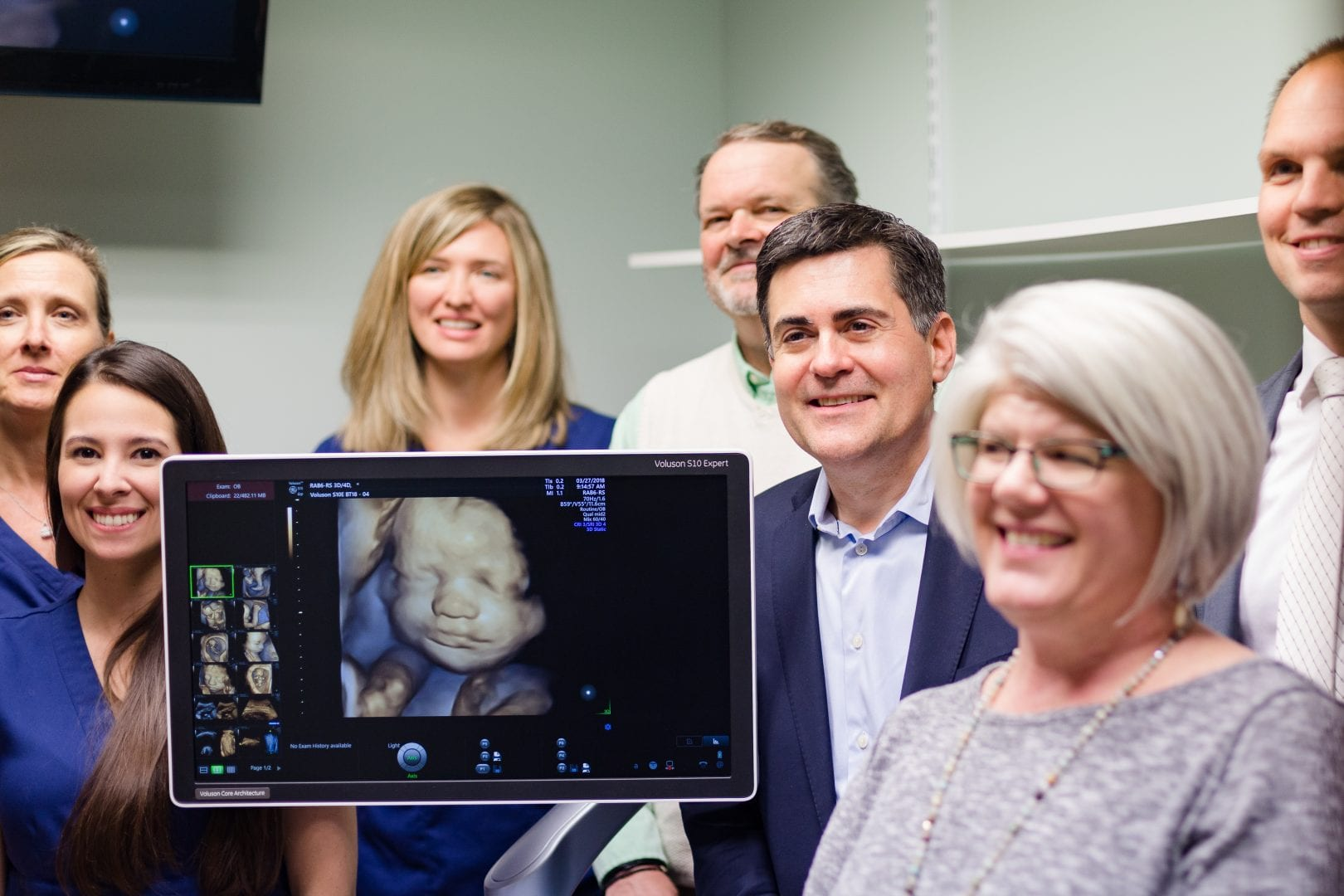 Russell Moore poses with Human Coalition staff